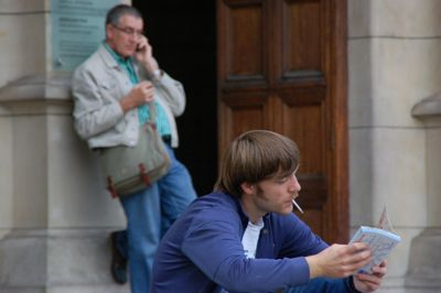 a cigarette and a cellphone / London